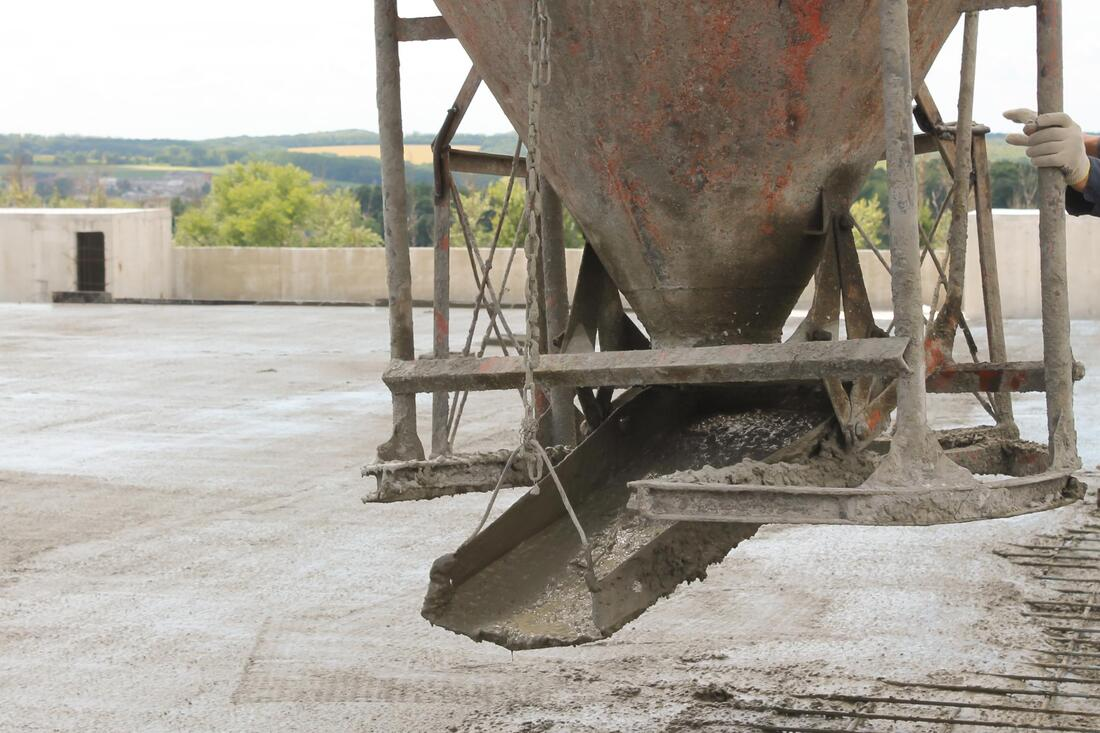 a concrete mixer pouring concrete